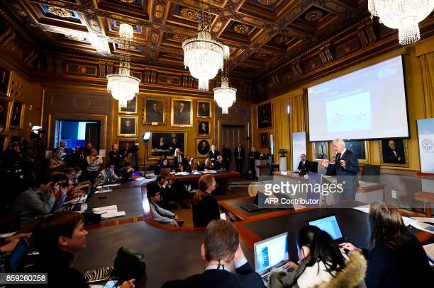 Member of the comittee for the Nobel Economics Prize Peter Gardenfors speaks next to Chairman of the comittee for the Nobel Economics Prize Per...