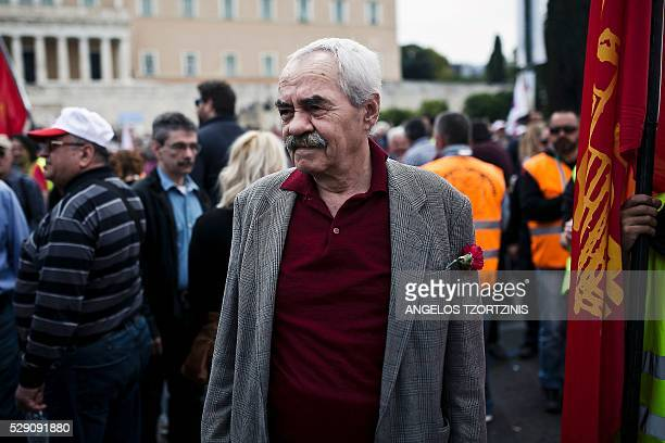 TOPSHOT A member of the communistaffiliated PAME union attends a rally commemorating May Day which was postponed due to the Greek Orthodox Easter in...