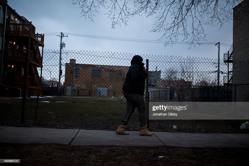 A member of the community leaves a vigil for slain infant Jonylah Watkins on March 12, 2013 in Chicago, Illinois. The 6-month-old girl was shot five times on the 6500 block of South Maryland Avenue while her father was changing her diaper in the passenger seat of his car. The father, Jonathan Watkins remains is stable condition at Nothwestern Memorial Hospital after receiving three gunshot wounds.