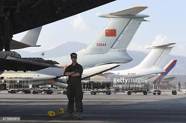 A member of the crew of a US C17 transport plane that came to Kathmandu to drop off a helicopter to help in the rescue and relief efforts stands next...