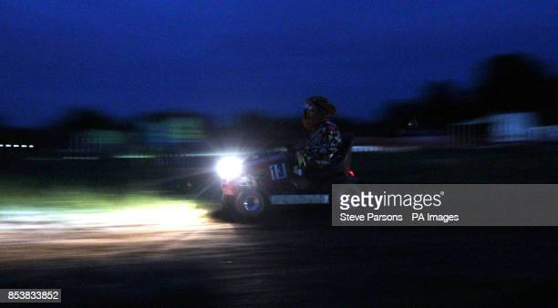 A member of the Cricketers Arms Two and a Half men team compete in the dark in the British Lawn Mower Racing Association 12 hour British Lawn mower...