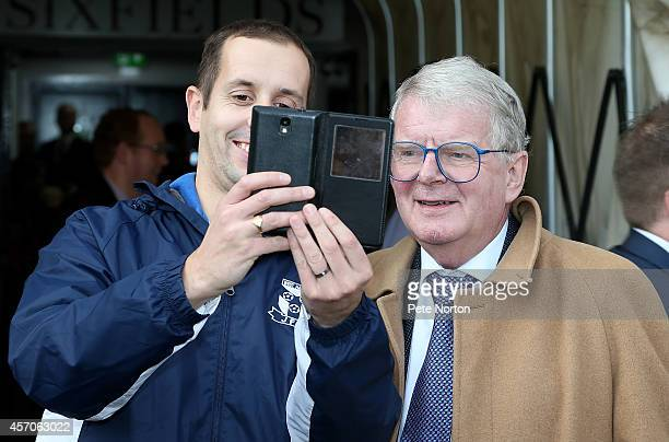 A member of the crowd has a selfie with Football commentator John Motson prior to the Sky Bet League Two match between Northampton Town and Burton...