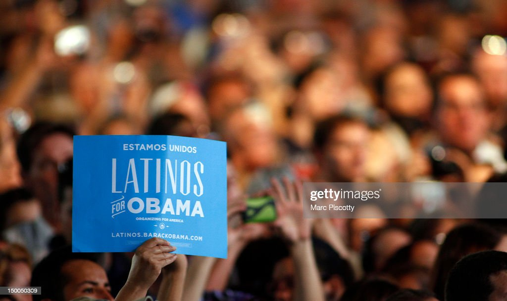 A member of the crowd holds up a 'Latinos for Obama' sign during a campaign speech by U.S. President Barack Obama at the Palace of Agriculture on the Colorado State Fairgrounds August 9, 2012 in Pueblo, Colorado. Obama covered a number of topics including paying down our debt in a balanced way, job growth and creation and preventing a scheduled tax increase.