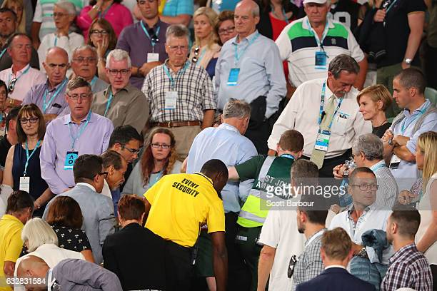 A member of the crowd is attended to by an ambulance officer during the semifinal match between Grigor Dimitrov of Bulgaria and Rafael Nadal of Spain...