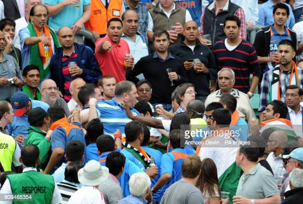 A member of the crowd is restrained after fighting with an Indian fan during the Third One Day International at The Kia Oval London