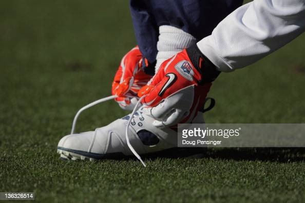 A member of the DENVER BRONCOS ties his shoe during warm ups prior to facing the Kansas City Chiefs at Sports Authority Field at Mile High on January...