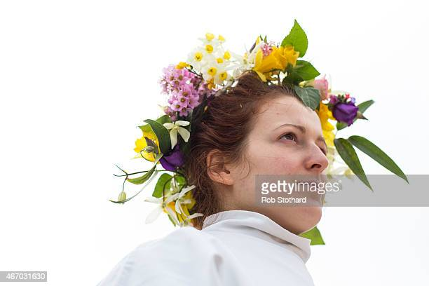 A member of The Druid Order representing Ceridwen the Earth Goddess' attendants wearing flowers in her hair celebrates the Spring Equinox at a...