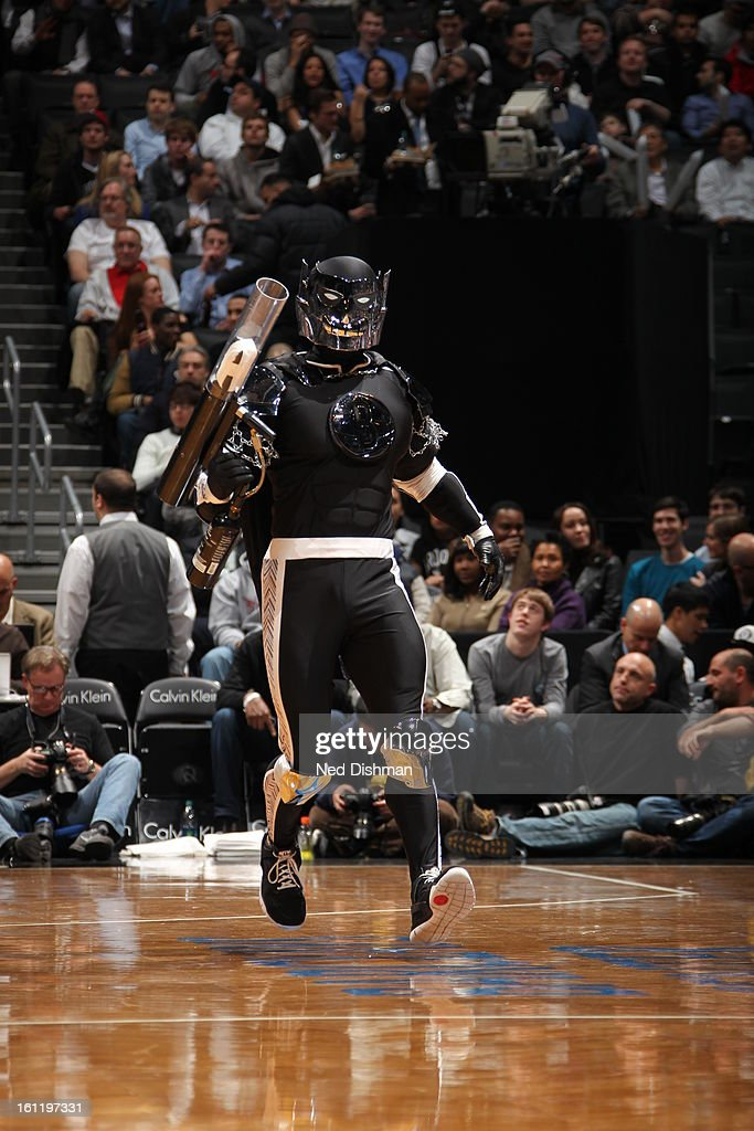 A member of the Dunk Squad looks to shoot tee-shirts into the stands in a game against the the Brooklyn Nets and the Toronto Raptors at the Barclays Center on January 15, 2013 in the Brooklyn borough of New York City in New York City.