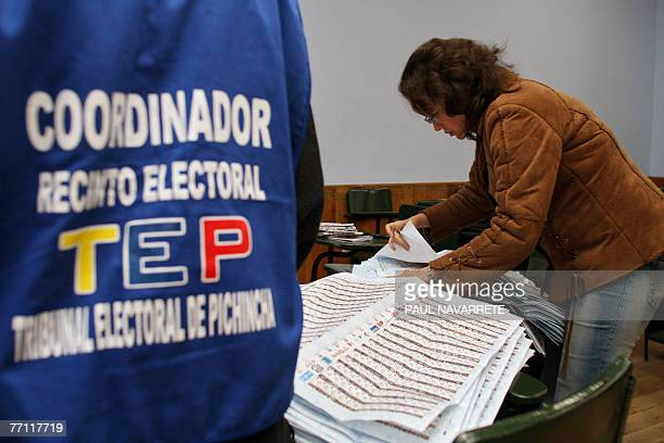 A member of the Ecuadorean Electoral Council counts votes at a polling station upon the closing of the election of the members of the Constituent...