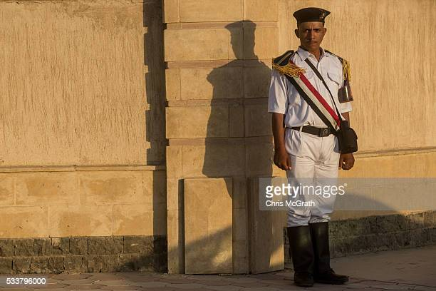 A member of the Egyptian police force stand guard outside the ElMosheer Tantawy Mosque ahead of the memorial ceremony held by EgyptAir for realtives...