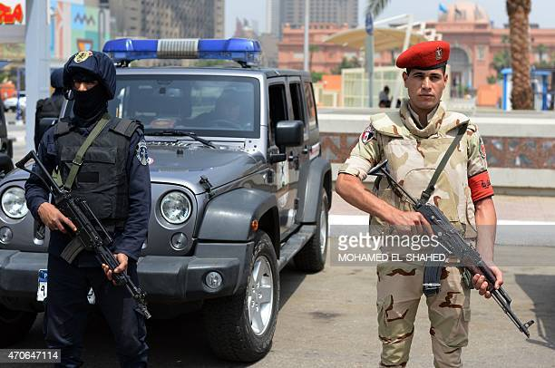 A member of the Egyptian special forces and a soldier stand guard outside the Arab League headquarters in Cairo on April 22 as Army chiefs from Arab...