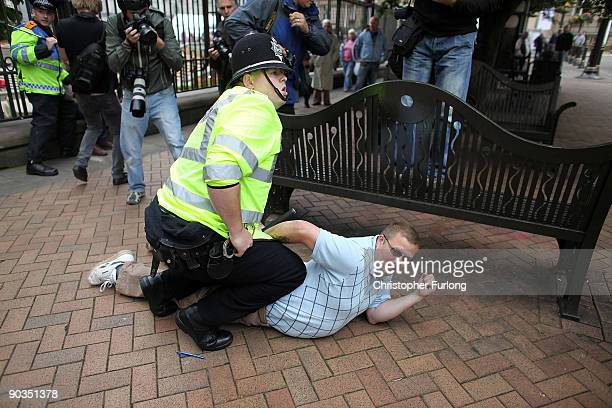 Member of the English Defence League is arrested during a rally on September 5 2009 in Birmingham England The English Defence League are holding...
