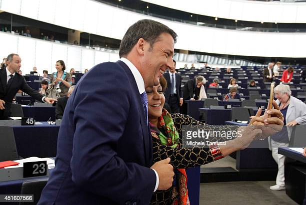 A member of the EU Parliament takes a ' Selfie' photo with the Italian Prime Minister Matteo Renzi after he delivered a speech to the plenary room in...