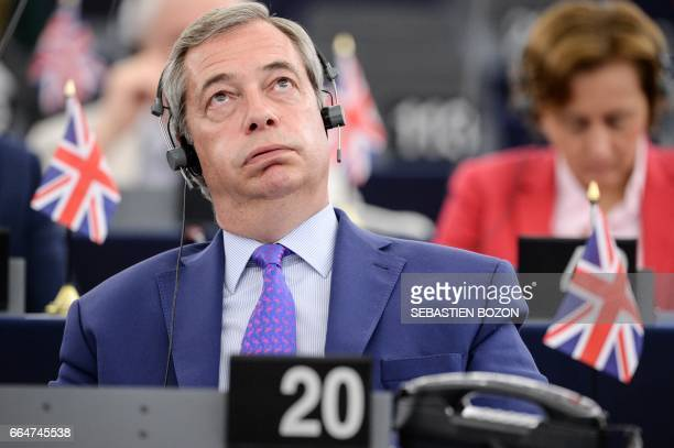 TOPSHOT Member of the European Parliament and former leader of the antiEU UK Independence Party Nigel Farage gestures during speeches at the European...