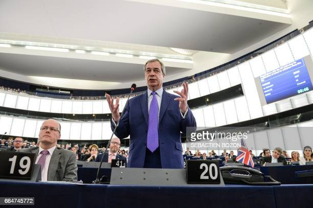 Member of the European Parliament and former leader of the antiEU UK Independence Party Nigel Farage gestures as he speaks at the European Parliament...