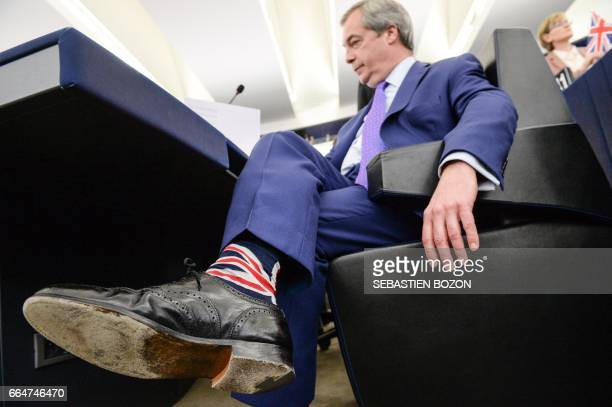 Member of the European Parliament and former leader of the antiEU UK Independence Party Nigel Farage wears socks with Union Jack flag at the European...