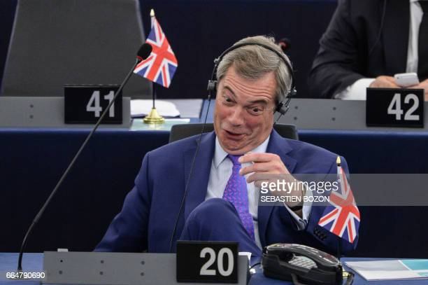 Member of the European Parliament and former leader of the antiEU UK Independence Party Nigel Farage gestures and reacts during a series of speeches...
