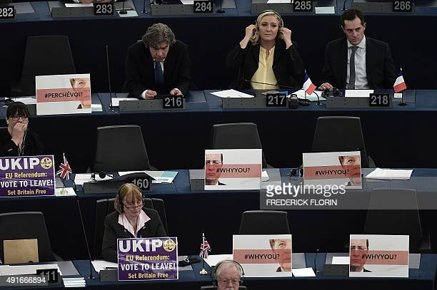 Member of the European Parliament and of UK Independence Party Julia Reid displays a placard reading 'UKIP EU referendum Vote to leave Set Britain...
