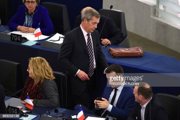 Member of the European Parliament Nigel Farage walks past French farright Front National party VicePresident Florian Philippot during a voting...