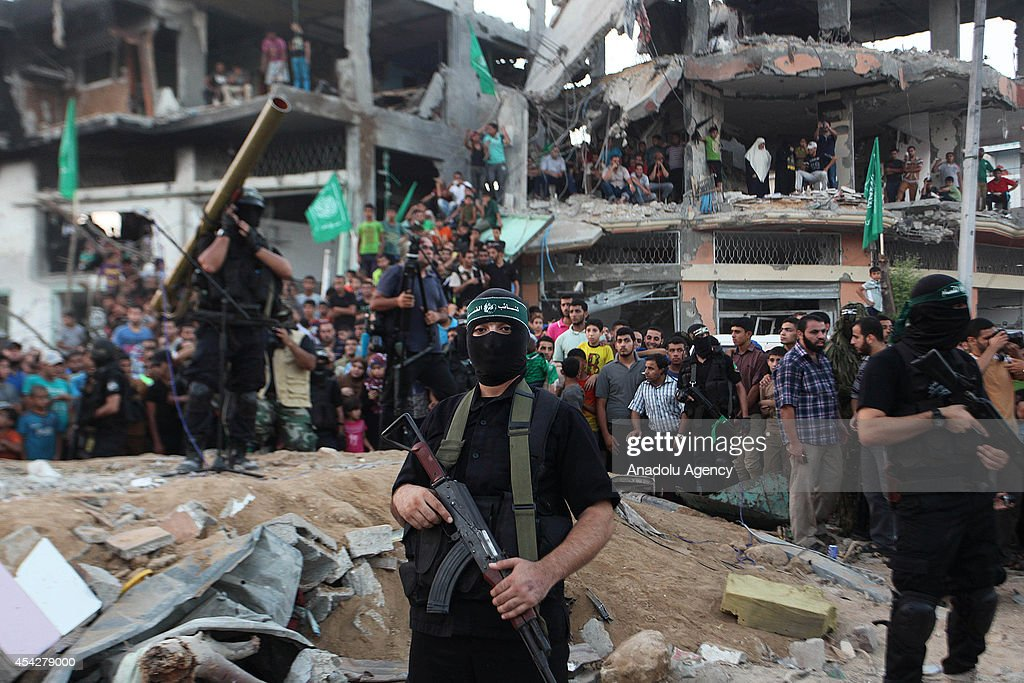 A member of the Ezzeddin al-Qassam Brigades, the armed wing of Palestinian resistance faction Hamas, stands guard during their press statement in the Shujaya neighborhood in eastern Gaza City on August 27, 2014.