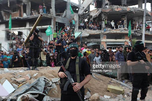 A member of the Ezzeddin alQassam Brigades the armed wing of Palestinian resistance faction Hamas stands guard during their press statement in the...