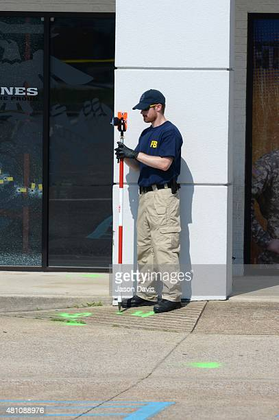 A member of the FBI Evidence Response Team gathers information at Armed Forces Career Center/National Guard Recruitment Office on July 17 2015 in...