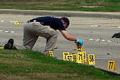 A member of the FBI Evidence Response Team investigates the crime scene outside of the Curtis Culwell Center after a shooting occurred the day before...