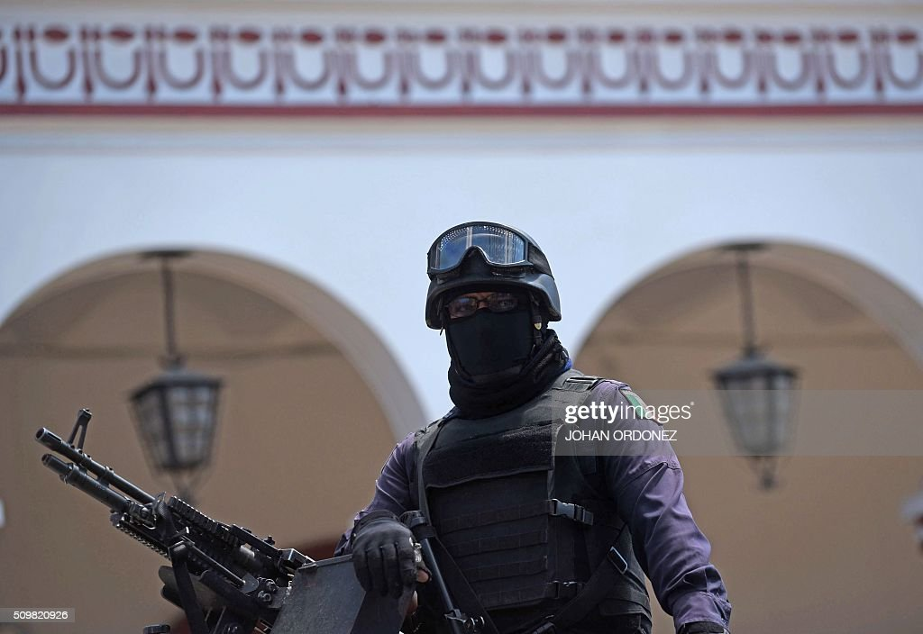 A member of the Federal Police patrols the streets of San Cristobal de las Casas, Chiapas State, Mexico on February 12, 2016. Pope Francis will arrive in Mexico on Friday, where he will visit until February 17. AFP PHOTO/Johan ORDONEZ / AFP / JOHAN ORDONEZ