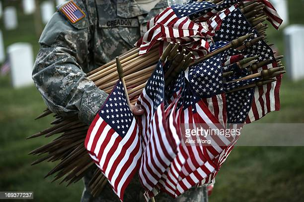 A member of the Fife and Drum Corps of the 3rd US Infantry Regiment 'The Old Guard' participate in a 'FlagsIn' ceremony May 23 2013 at Arlington...