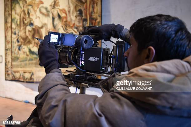 A member of the film crew works in the Chateau of Chambord during the shooting of the Indian action film 'Junga' on October 5 2017 The film in Tamil...