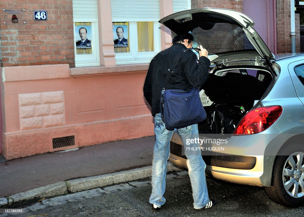 A member of the Financial police leaves the headquarters of the French socialist party federation of the Pas-de-Calais, on December 6, 2012 in Lens, after a search as part of an inquiry into an alleged hidden financing of this federation, involving local MP Jean-Pierre Kucheida.