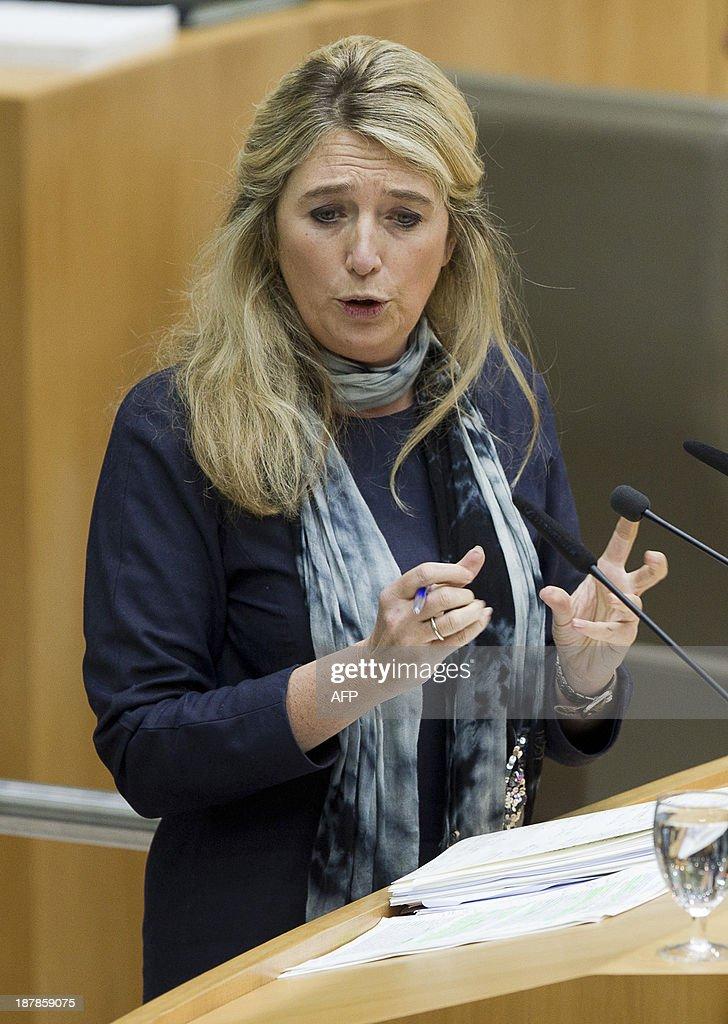 Member of the Flemish parliament for the Belgian Open Vld party Mercedes Van Volcem speaks during a plenary session of the Flemish Parliament in Brussels on November 13, 2013. AFP PHOTO / BELGA / KRISTOF VAN ACCOM **BELGIUM OUT**
