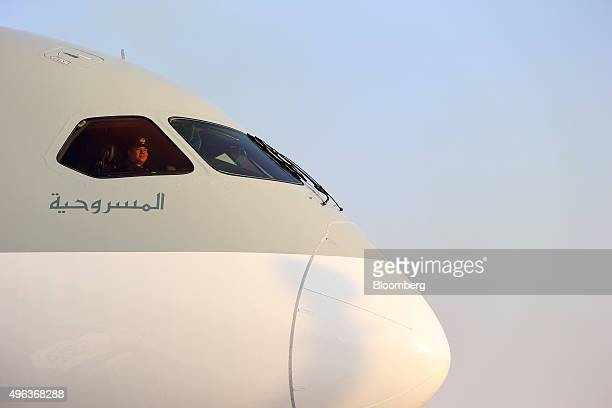 A member of the flight crew sits in the cockpit of a Boeing Inc 787800 Dreamliner aircraft operated by Qatar Airways Ltd on the opening day of the...