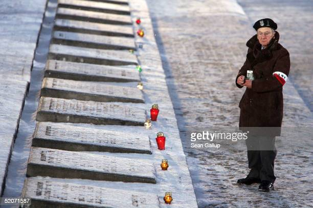 A member of the former Polish armed resisitance against the Nazis prepares to light a candle at the main memorial during ceremonies marking the 60th...