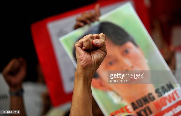 A member of the Free Burma Coalition raises a clenched fist during a rally in front of the Myanmar's embassy in Manila on September 24 in...