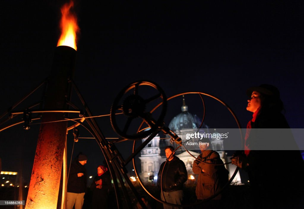 A member of the French fire performers group Carabosse gives fuel to a paraffin wax-powered flame in front of the Berliner Dom (Berlin Cathedral) as part of celebrations marking the 775th anniversary of the city of Berlin on October 28, 2012 in Berlin, Germany. The settlement of Coelln, which stood opposite Berlin on the Spree river, is first referred to in a document from 1237, and by the beginning of the 14th century Coelln and Berlin joined together to become the region's most important trading center.