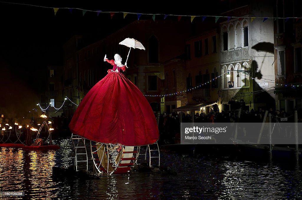 A member of the French theatre company, Ilotopie, dressed as a Queen performs on the Cannaregio Canal on January 26, 2013 in Venice, Italy. Today saw the opening of the Venetian Carnival, which runs till February 12th.