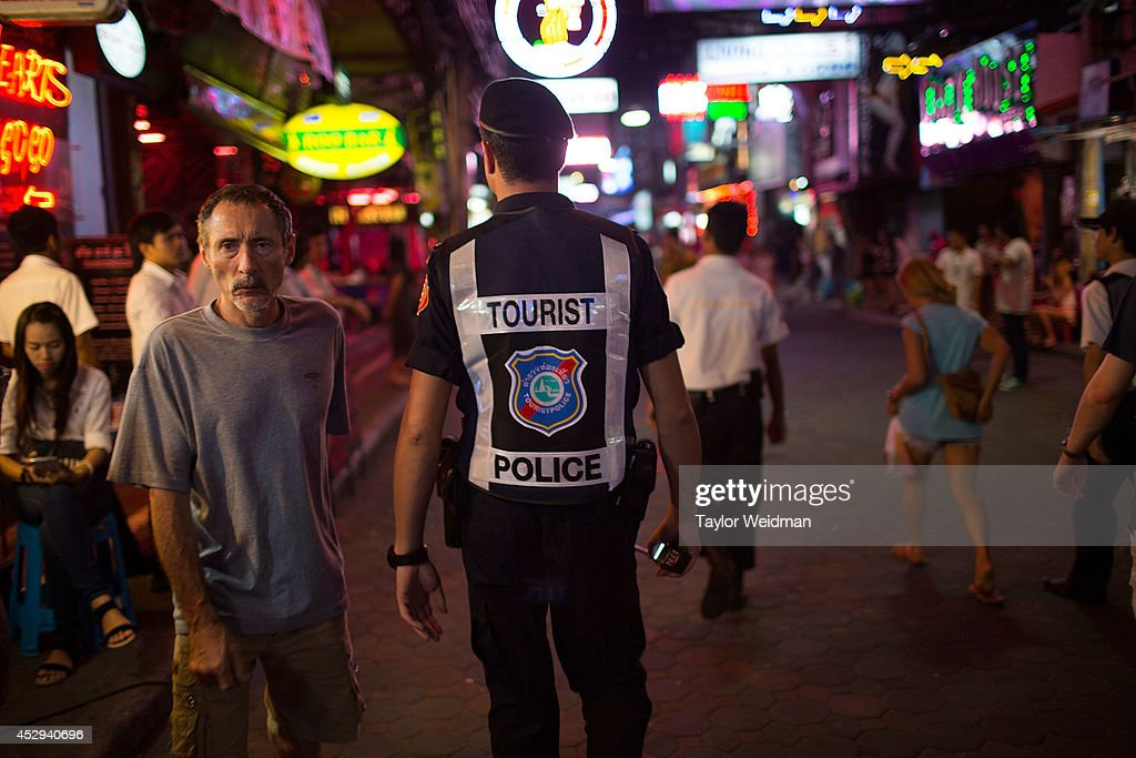 A member of the FTPA patrols Pattaya's Walking Street on July 31, 2014 in Pattaya, Thailand. Since 2002, members of the Foreign Tourist Police Assistants (FTPA) of Pattaya have been assisting local police on Walking Street, Pattaya's main nightlife area. Members of the FTPA carry handcuffs, batons, and pepper spray, and are charged primarily with assisting foreign visitors and the Thai police, as well as breaking up fights and catching thieves.