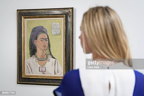 A member of the gallery team poses with 'Autorretrato' by artist Frida Kahlo at the Ordovas gallery on September 15 2016 in London England The work...