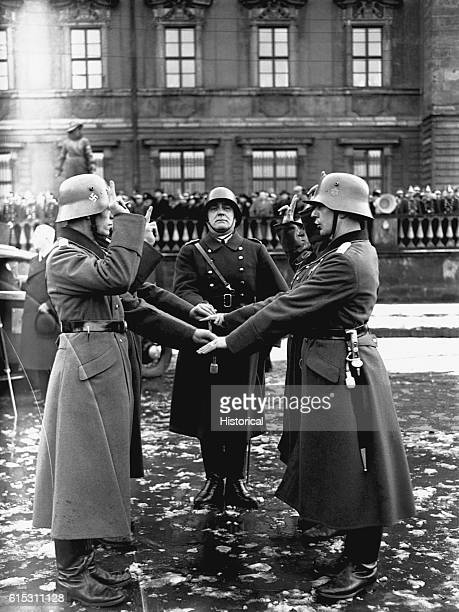 A member of the German army the Wehrmacht swears allegiance to Adolf Hitler