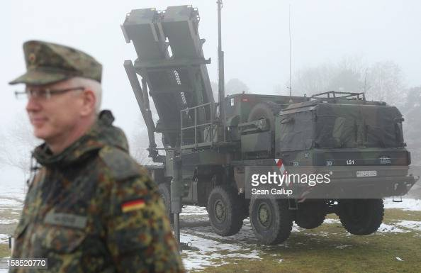 A member of the German Bundeswehr stands next to a Patriot missile launching system during a press day at the Luftwaffe Warbelow training center on...