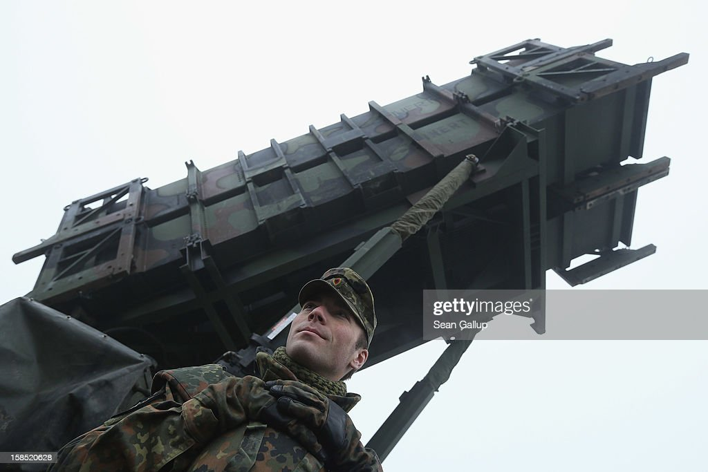 A member of the German Bundeswehr who will be sent to Turkey stands next to a Patriot missile launching system during a press day presentation at the Luftwaffe Warbelow training center on December 18, 2012 in Warbelow, Germany. Germany, along with the USA and the Netherlands, will send two Patriot systems and 400 soldiers to Turkey in January to protect Turkey from Syrian attacks.