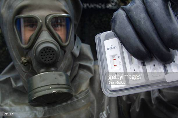 A member of the German Chemical Corps a part of the German military that specializes in antinuclear chemical and biological weapons operations holds...