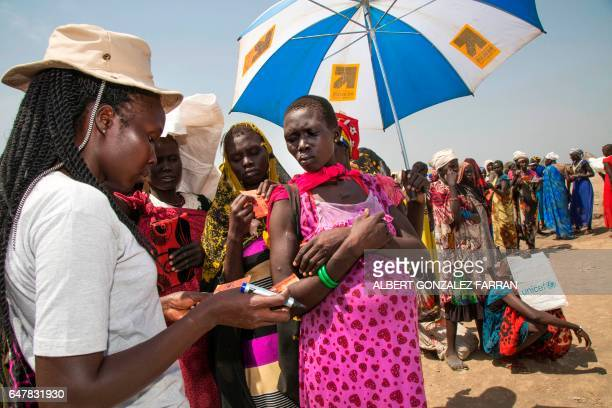 A member of the German NGO Welthungerhilfe registers a pregnant beneficiary of a food distribution on March 4 in Ganyiel Panyijiar county in South...