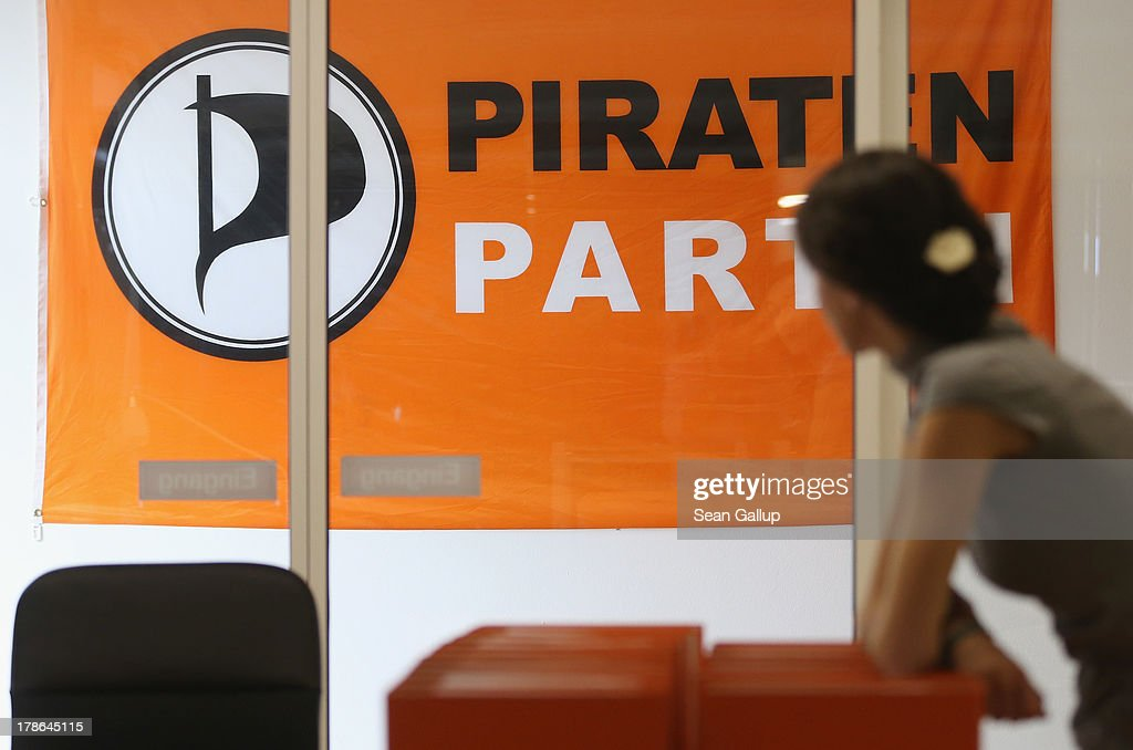 A member of the German Pirates Party (Die Piraten) leans over folders next to a Pirates flag at the party regional election campaign headquarters on August 30, 2013 in Berlin, Germany. Germany is scheduled to hold elections on September 22 and the Pirates, who last year rode a wave of popularity that won them seats in several state parliaments, have since faltered and are unlikely to win the 5% minimum needed to gain seats in the Bundestag.