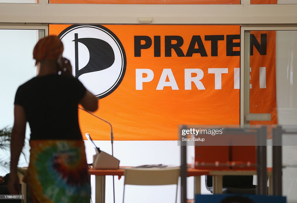 A member of the German Pirates Party (Die Piraten) walks past a Pirates flag at the party regional election campaign headquarters on August 30, 2013 in Berlin, Germany. Germany is scheduled to hold elections on September 22 and the Pirates, who last year rode a wave of popularity that won them seats in several state parliaments, have since faltered and are unlikely to win the 5% minimum needed to gain seats in the Bundestag.