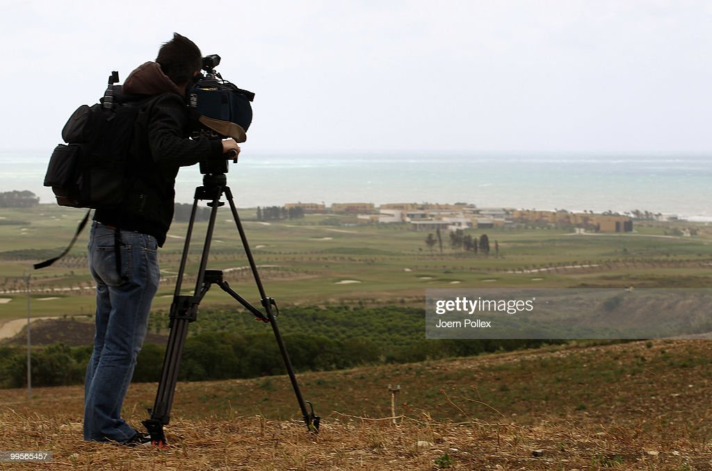 A member of the German press is pictured at the gate of the Verdura Golf and Spa Resort where the Geman National Football Team stays for training on May 15, 2010 in Sciacca, Italy.