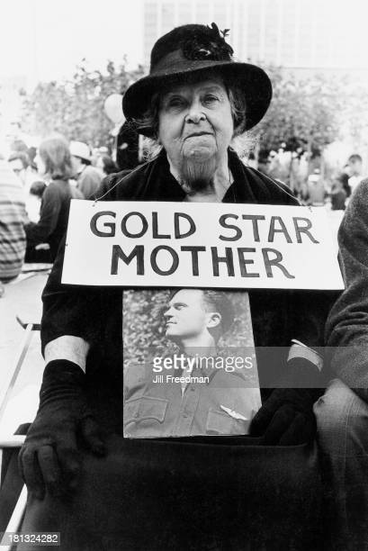 A member of the 'Gold Star Mothers Club' at an antiVietnam War demonstration shows a picture of her son killed in World War II San Francisco...