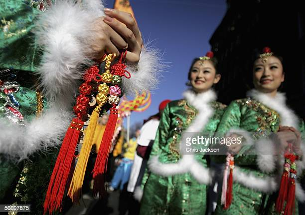 A member of the Golden Sail Dance troop holds prayer beads during Chinese New Year Celebrations January 29 2006 in London England More than 80000...
