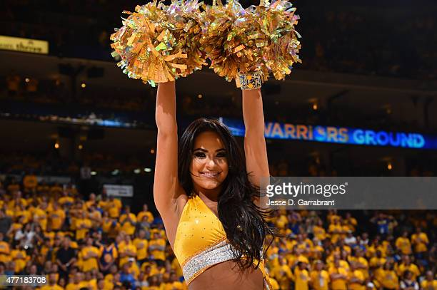 A member of the Golden State Warriors dance team cheers against the Cleveland Cavaliers at the Oracle Arena During Game Five of the 2015 NBA Finals...